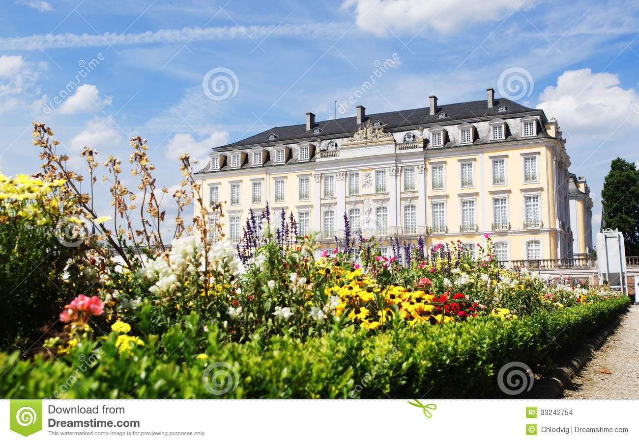 Bruhl Palace Augustusburg With Flowers In Foreground Stock Images.