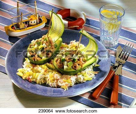 Stock Photo of Avocado boats filled with shrimps & braising.