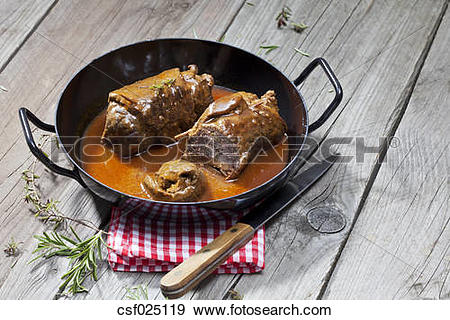 """Stock Photograph of """"Beef roulades in braising pan, rosmary."""