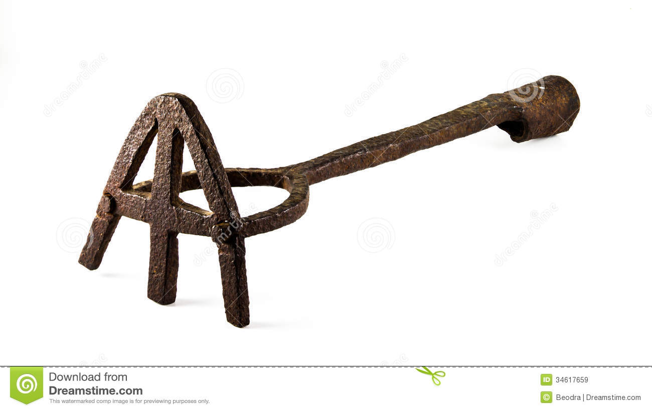 Branding iron for cattle stock image. Image of embers.