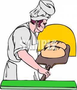 Chef Putting Two Loaves of Bread In the Oven.