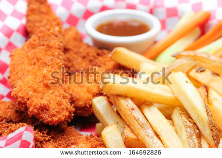 Chicken Tenders And French Fries In A Basket Breaded Chicken.
