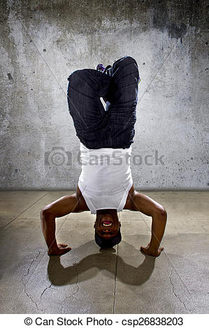 Stock Photography of Urban Dancer Doing a Headstand or Yoga.