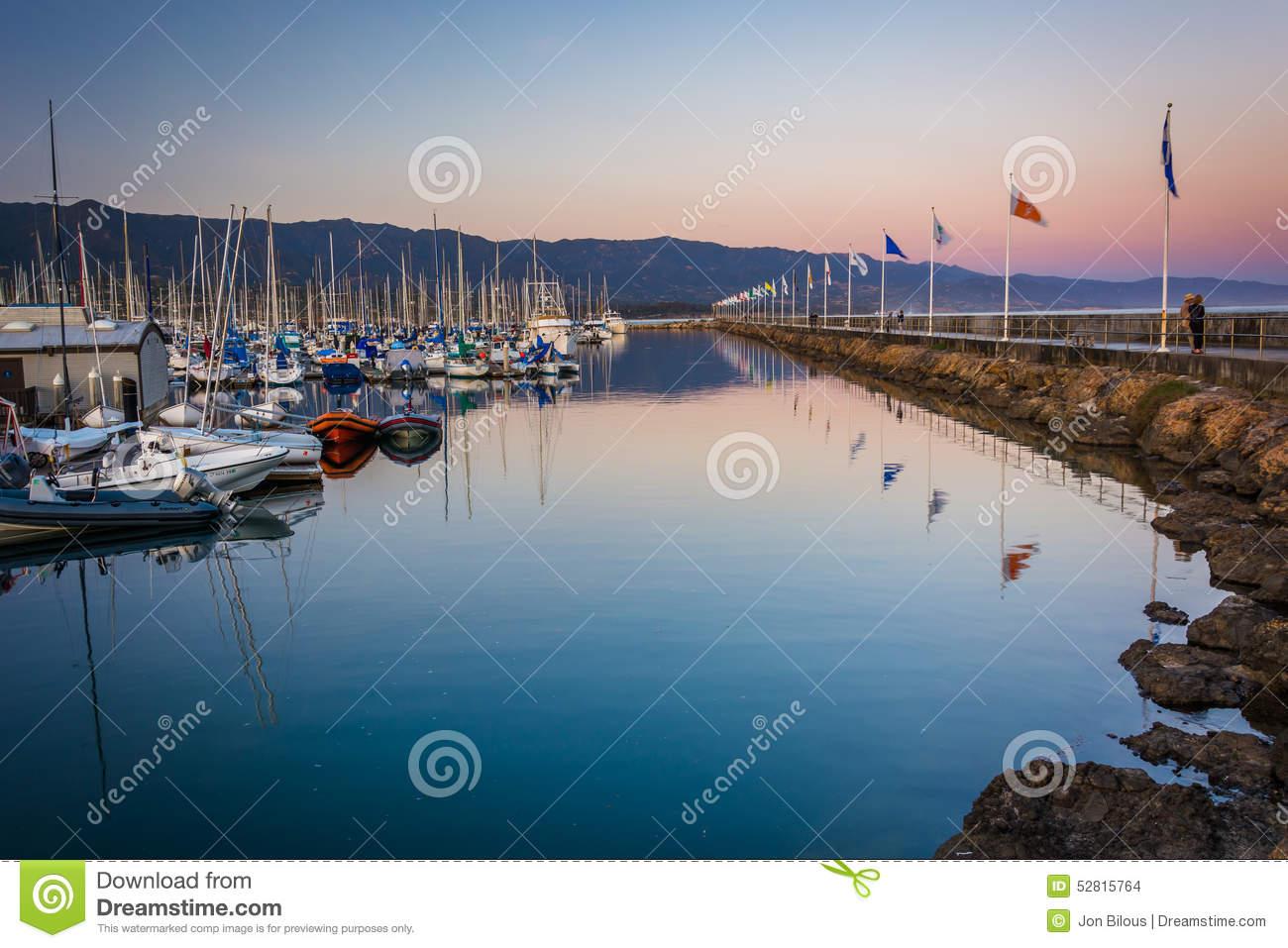 Breakwater And Boats At The Harbor At Sunset, In Santa Barbara.
