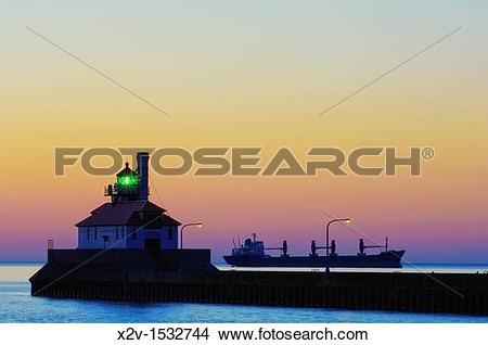 Stock Photo of A ship awaits entry into Duluth Harbor outside of.