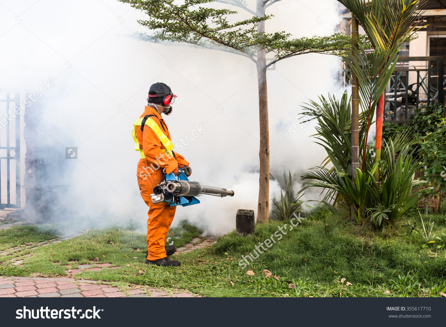 Worker Fogging Residential Area Insecticides Kill Stock Photo.