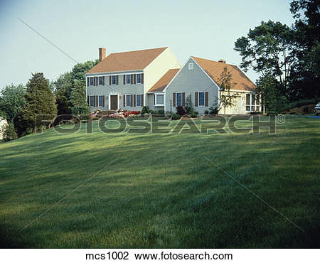 Stock Photo of Frame house with enclosed breezeway to garage.