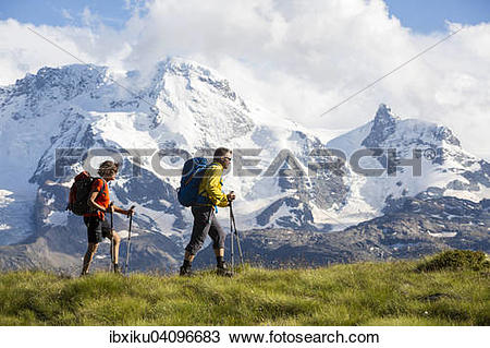 Stock Photo of A man and a woman hiking, Schweifinen Plateau at.