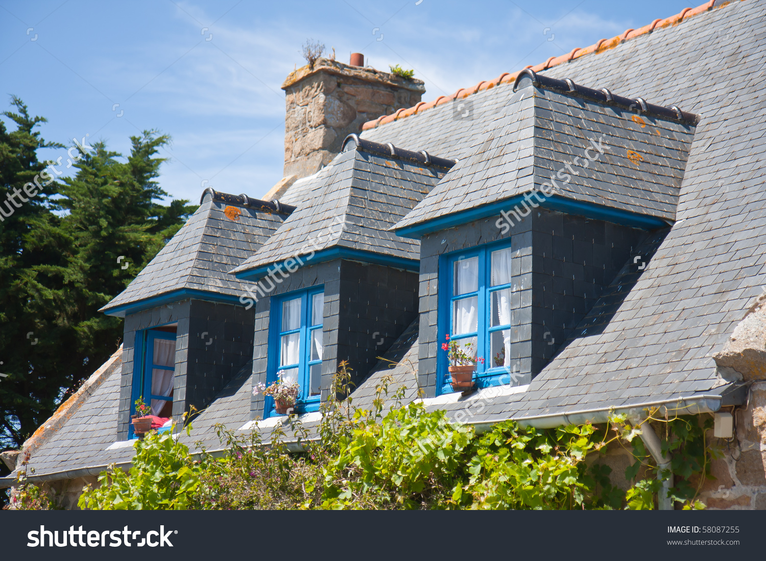 Traditional Breton House With Typical Dormers And Shutters In.