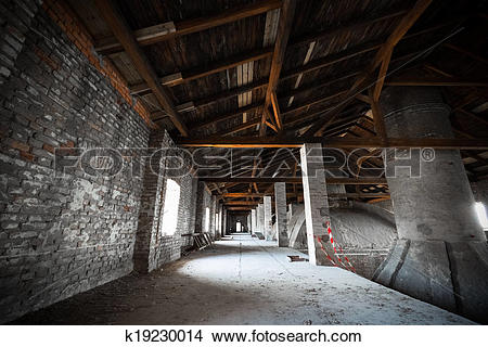 Stock Photo of old desolate brewery attic of his, his chimneys.