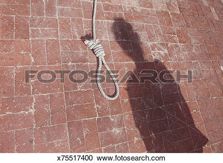 Stock Photography of A noose rests on a brick floor by a man's.