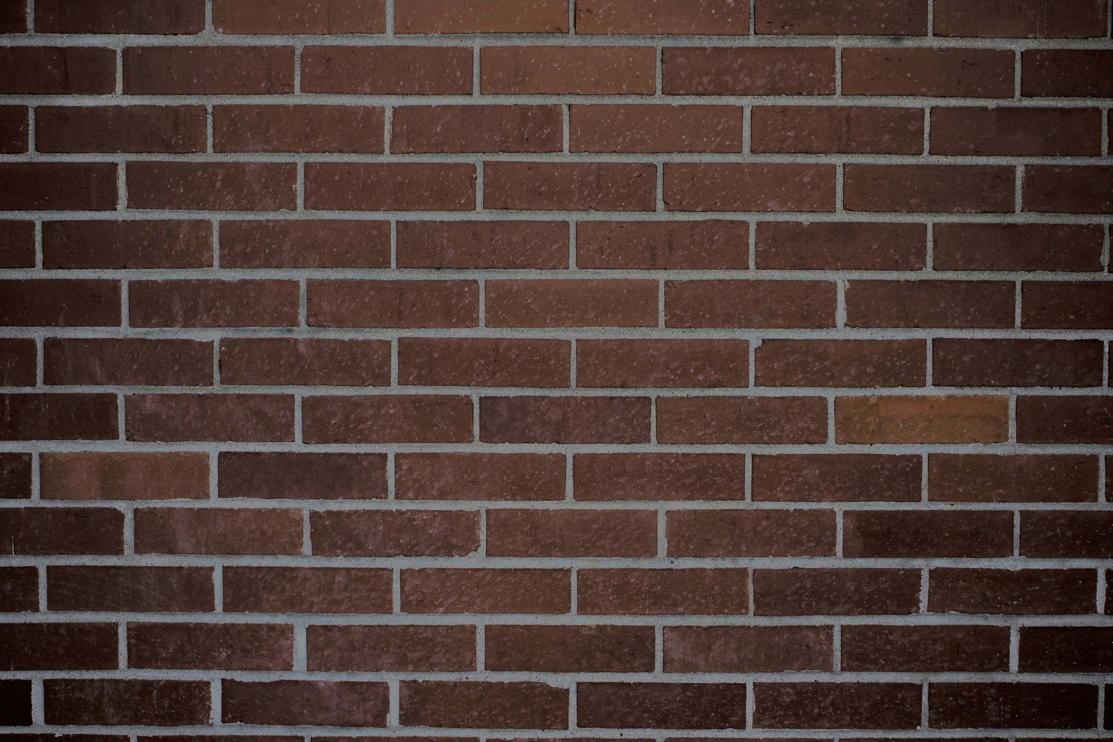 Dark Brown Brick Wall Texture.