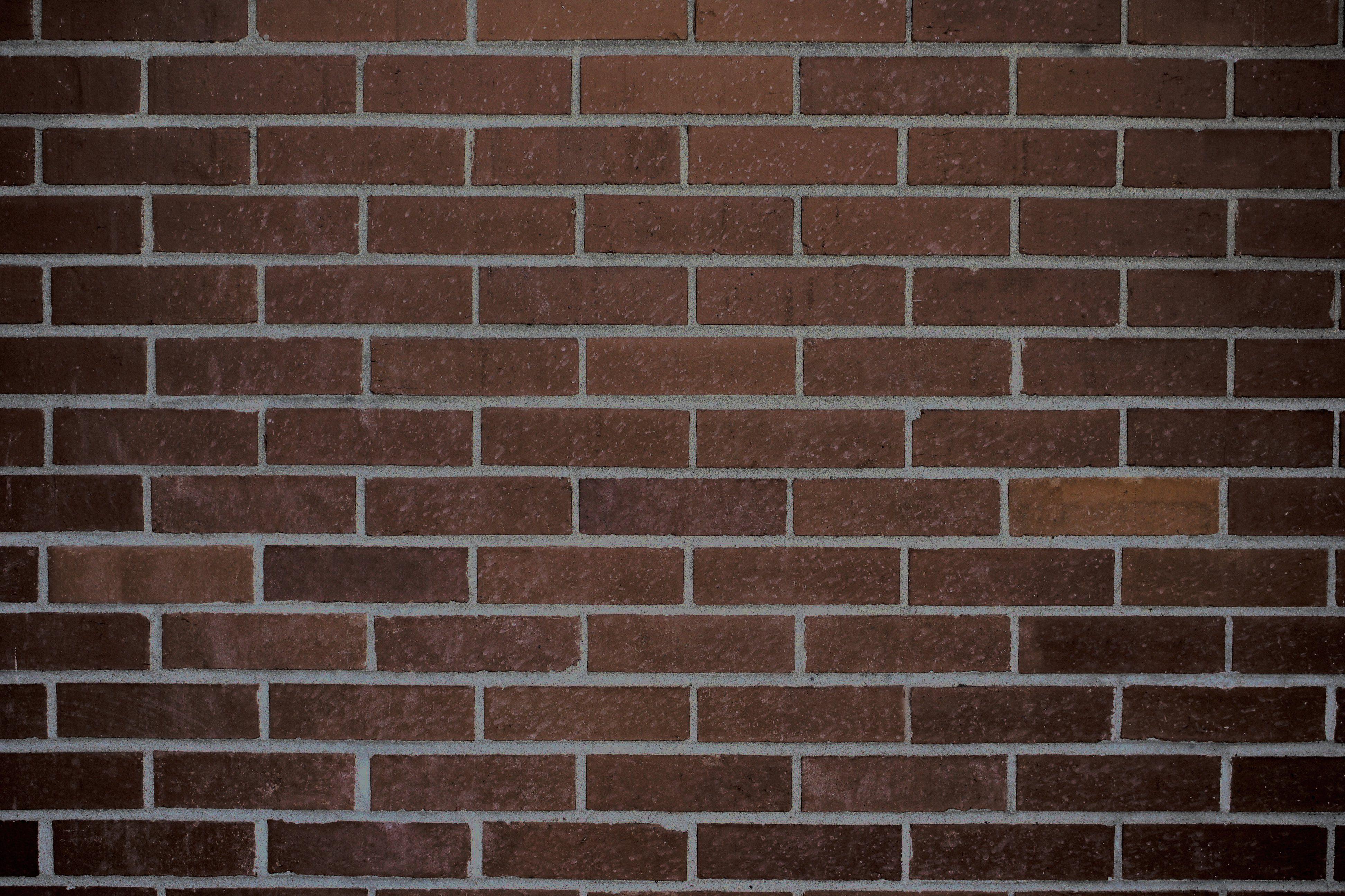 Dark Brown Brick Wall Texture.