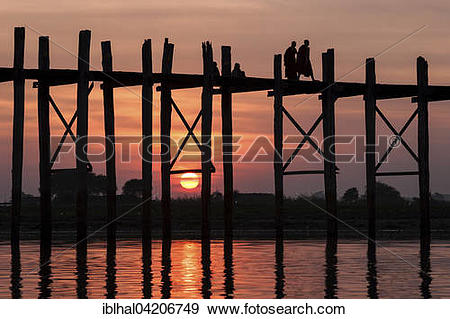 Stock Photograph of Two monks walking on the U Bein Bridge.