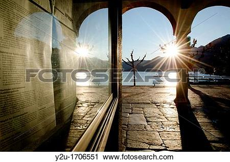 Stock Photography of Alley in backlight and reflected in a window.