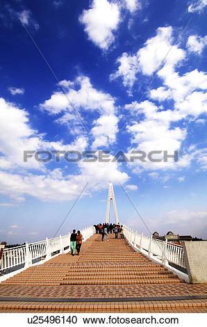 Stock Photography of Tourists walking on a bridge, Lovers Bridge.