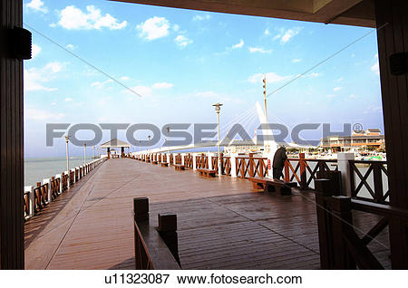 Picture of Pier with bridge in the background, Lovers Bridge.