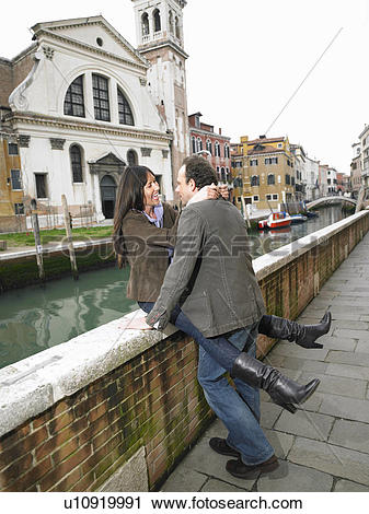 Stock Photography of Couple embracing on parapet. Dorsoduro.