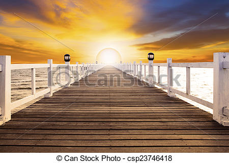Stock Photography of sun set scene and old wood bridge pier with.