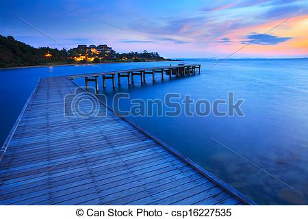 Stock Photos of wood bridge pier into blue sea at morning time use.