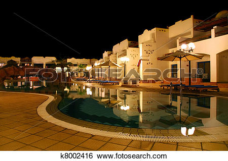 Stock Images of hotel with pool and bridge under it, umbrellas and.