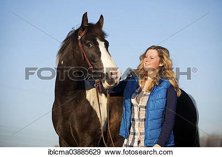 "Stock Photograph of ""Girl with a Paint Horse, brown tobiano."