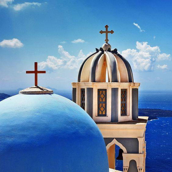 Crosses top the Blue Domes of the Greek Orthodox Church, Greek.