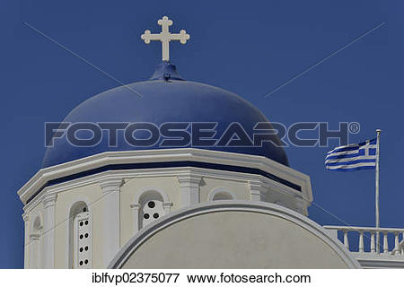 """Picture of """"Greek flag flying next to a bright blue church dome."""