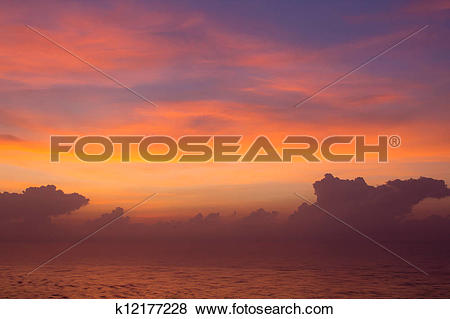 Pictures of Beautiful sunrise above the lake with bright clouds.