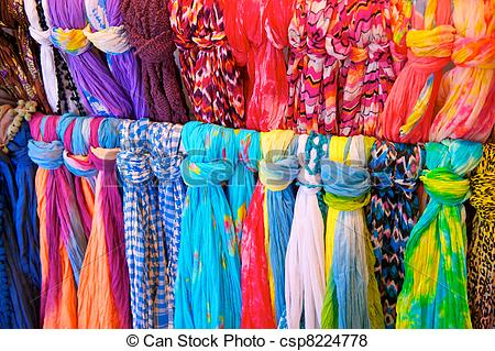 Pictures of Brightly Colored Scarves on Rack.