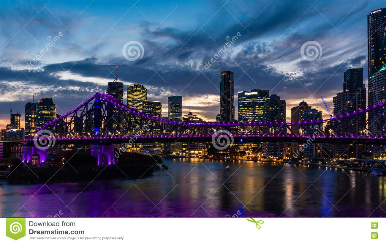 Vibrant Zooming Night Time Panorama Of Brisbane City With Purple.