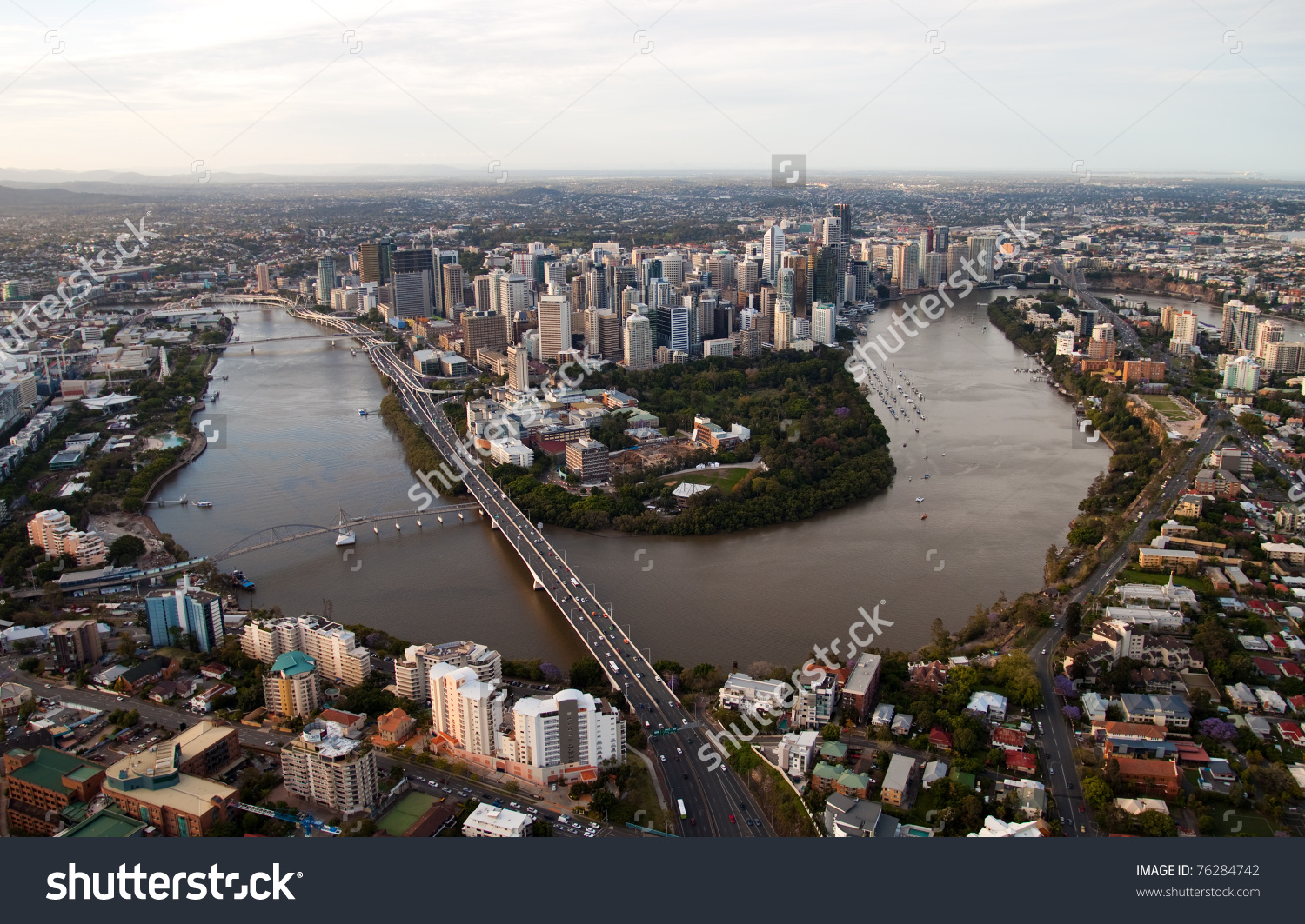 Aerial Image Of Brisbane At Dusk And The Brisbane River Meandering.
