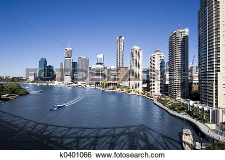 Stock Images of ferry on brisbane river with skyline k0401066.