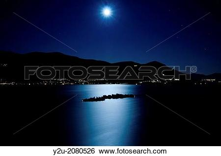 Stock Images of Moon light reflected over an alpine lake maggiore.