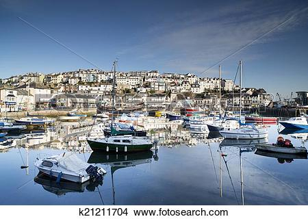 Stock Photo of fishing boats moored in brixham harbour, devon.