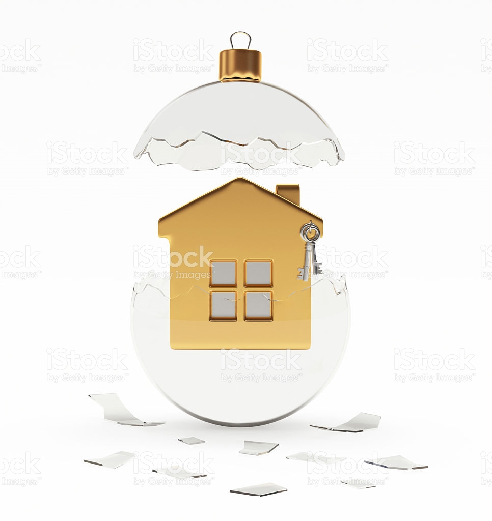 Broken Glass Christmas Ball With Golden House Inside On White.