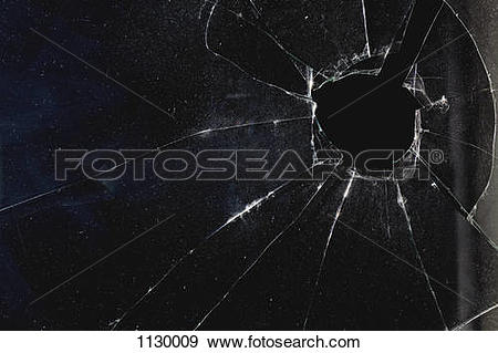 Stock Photograph of A window with a hole broken through the glass.
