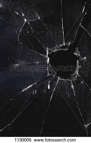 Stock Image of A window with a hole broken through the glass.