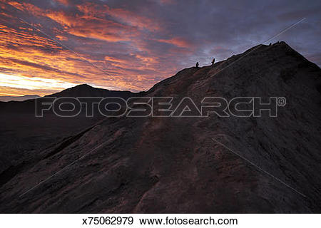 Stock Photograph of Trekkers going around the crater of Mount.