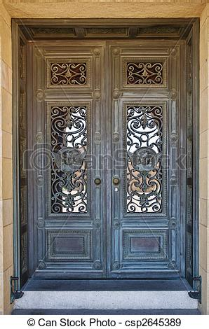 Stock Photographs of Classic door with bronze relief decoration.