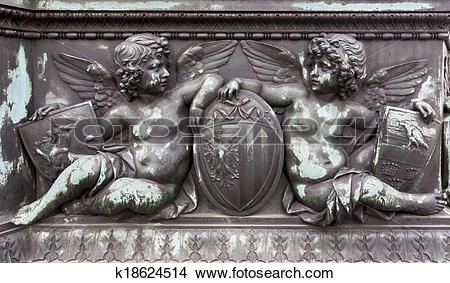 Stock Photo of Bronze relief of cherubs holding shields k18624514.