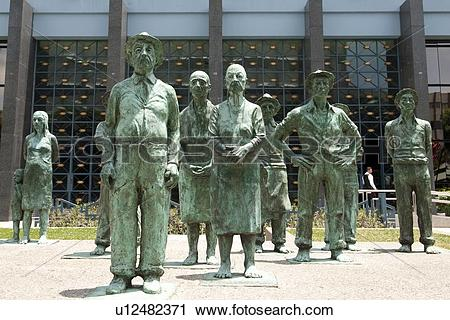 Stock Photography of Verdigris bronze statues of agricultural.