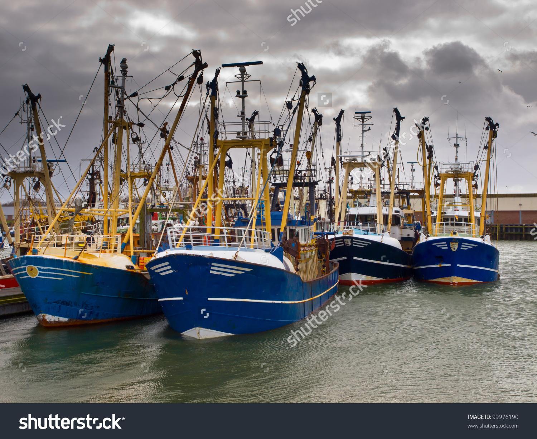 Modern Fishing Boats Under Brooding Sky Stock Photo 99976190.