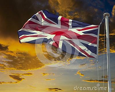 Union Jack On Flagpole Under Dark Brooding Sky. Royalty Free Stock.