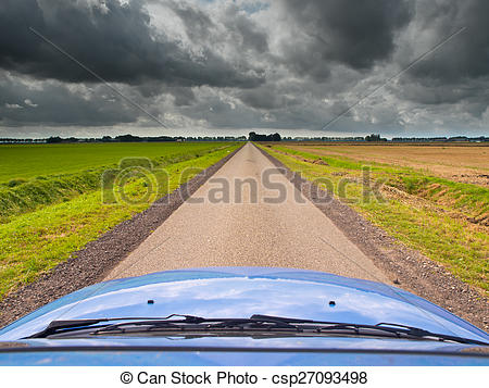 Stock Photographs of Straight Road under Brooding Sky.
