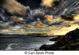 Stock Images of Brooding sky follows freighters at sea.