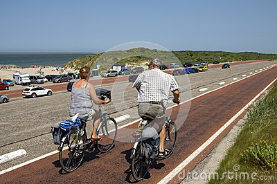 Older Couple Cycling On Brouwersdam, Netherlands Editorial.