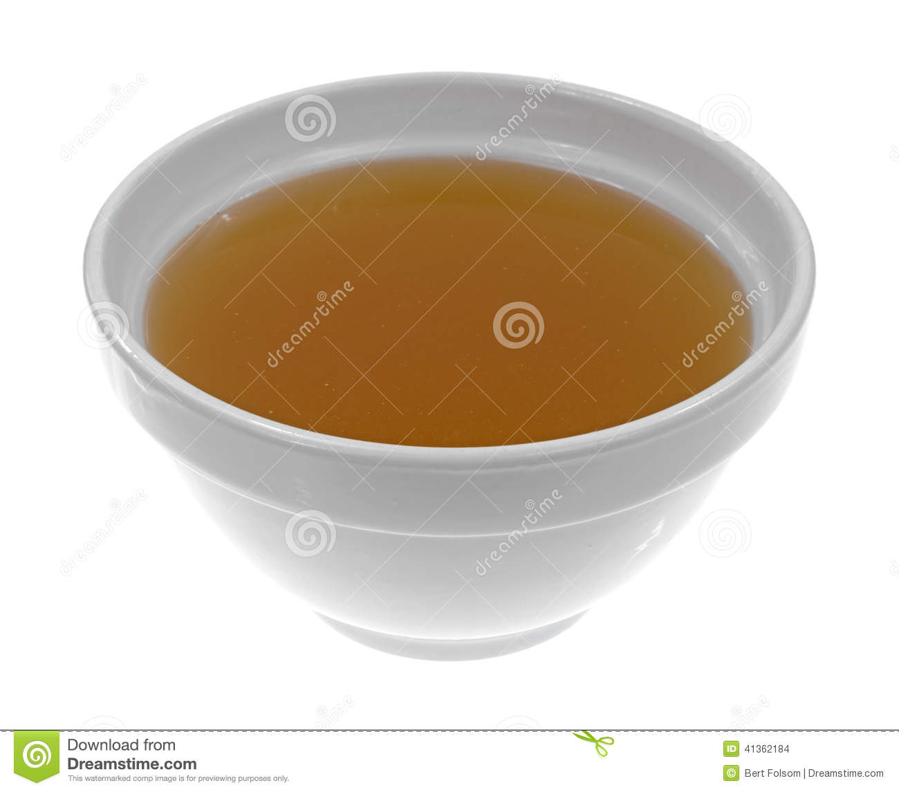 Bowl Of Clear Chicken Broth Stock Photo.
