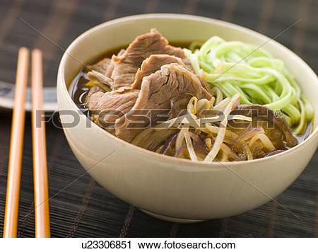 Stock Photography of Hot and Sour Beef Broth With Spinach Ramen.