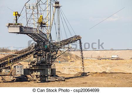 Stock Photographs of Opencast brown coal mine. Giant excavator.